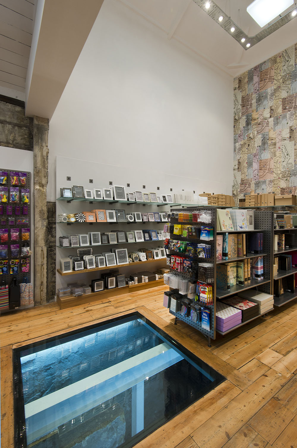 double height retail space with glass floor panel, Paperchase Bath