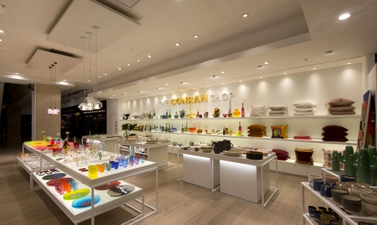 LED back lit wall mounted shelving units and tables at The Conran Shop, Selfridges, London